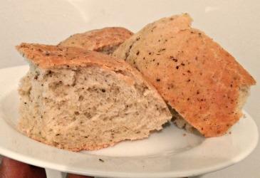 Plate of sliced herbal bread