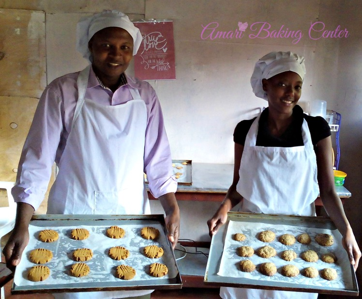 Mungai and Joy holding cookies-Amari Cookie class Oct 2016