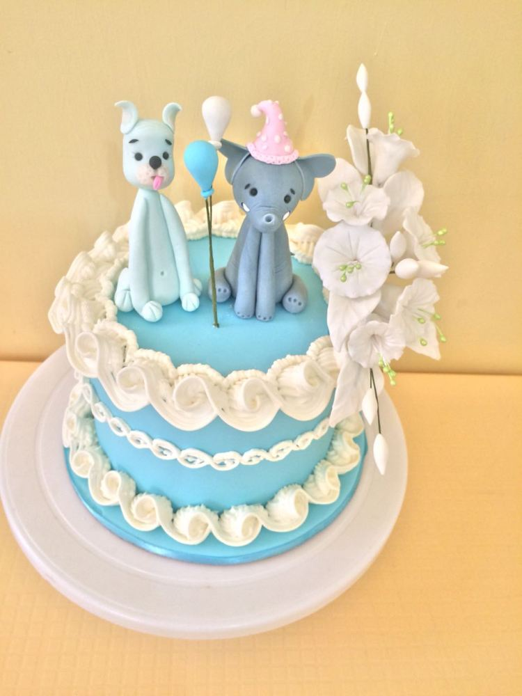 Blue cake with figurine and flowers by Evelyn - PurpleSugarcraft